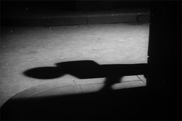 Shadows in the alley of The Seventh Victim produced by Val Lewton for RKO Radio Pictures, directed by Mark Robson, starring Tom Conway, Jean Brooks, Isabel Jewell, Kim Hunter, and Hugh Beaumont