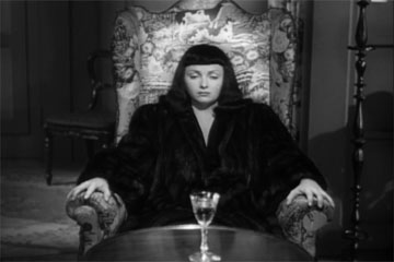 Jacqueline contemplating her forced suicide by poison in The Seventh Victim produced by Val Lewton for RKO Radio Pictures, directed by Mark Robson, starring Tom Conway, Jean Brooks, Isabel Jewell, Kim Hunter, and Hugh Beaumont
